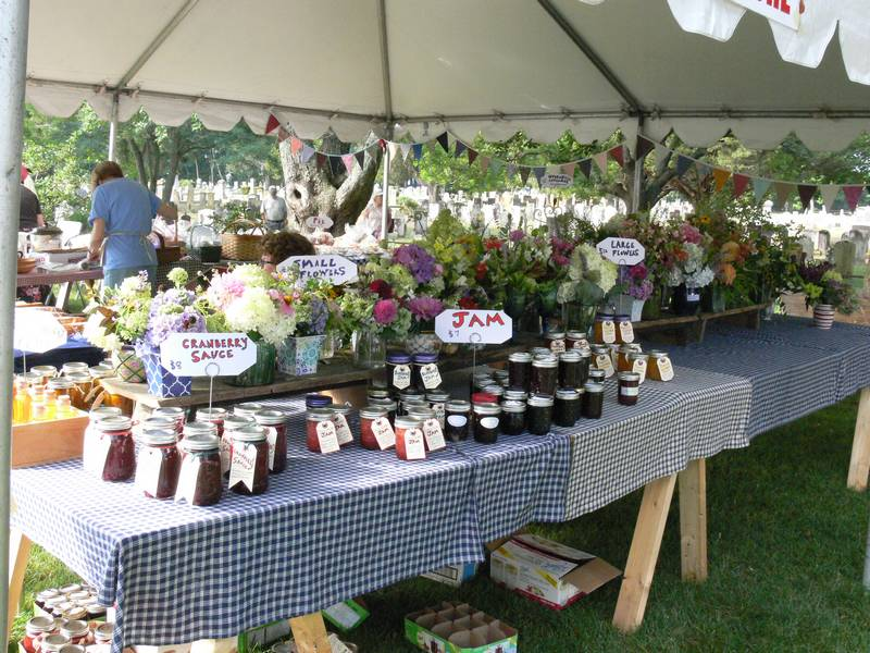 Many jars of homemade jam for sale