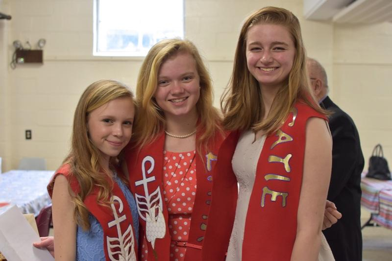 3 young women in their confirmation stoles